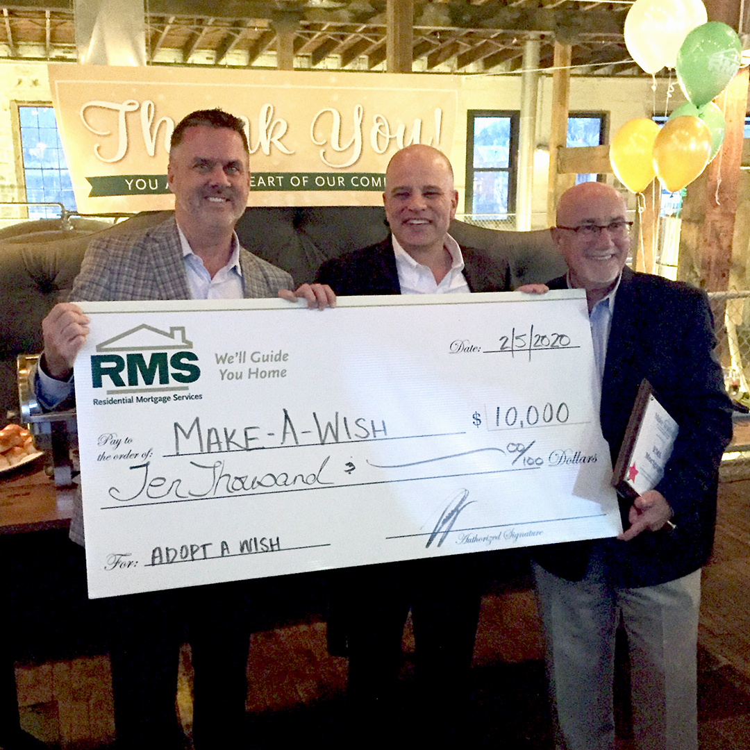 Bob Johnson of RMS, Jim Seely of RMS and Dennis Heron of Make-a-Wish hold a large check for ten thousand dollars to Make-A-Wish